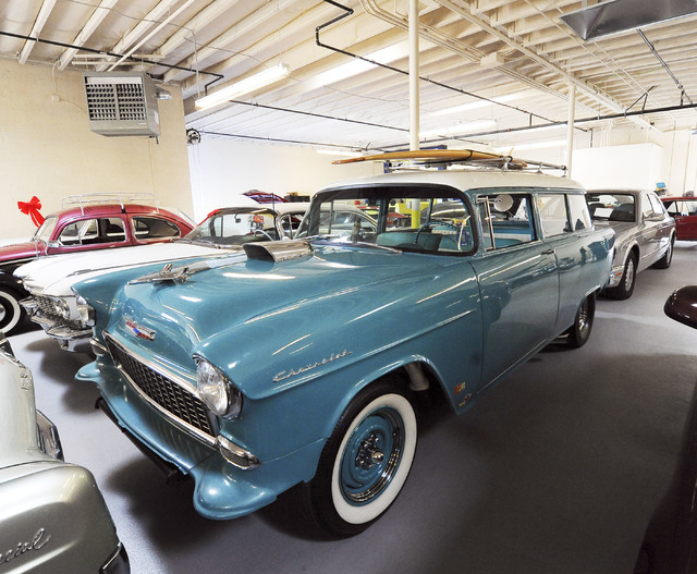 A classic 1955 Chevrolet station wagon with a surf board on the roof is seen at Classic & Collectable Cars in Las Vegas, Friday, Dec. 13, 2013. Michael Nicholl, the owner of the business, received ...