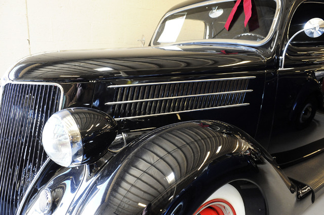 A 1936 Ford Deluxe Humpback Sedan is seen at Classic & Collectable Cars in Las Vegas, Friday, Dec. 13, 2013. Michael Nicholl, the owner of the business, received an SBA loan to turn a burned-out b ...