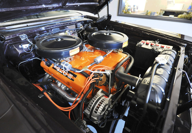 """A 426 cubic inch """"Wedge"""" sits in the engine bay of a 1964 Dodge Super Sport at Classic & Collectable Cars in Las Vegas, Friday, Dec. 13, 2013. Michael Nicholl, the owner of the business, ..."""