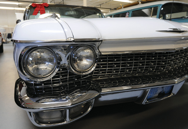 The grill and headlights of a 1960 Cadillac are seen at Classic & Collectable Cars in Las Vegas, Friday, Dec. 13, 2013. Michael Nicholl, the owner of the business, received an SBA loan to turn a b ...