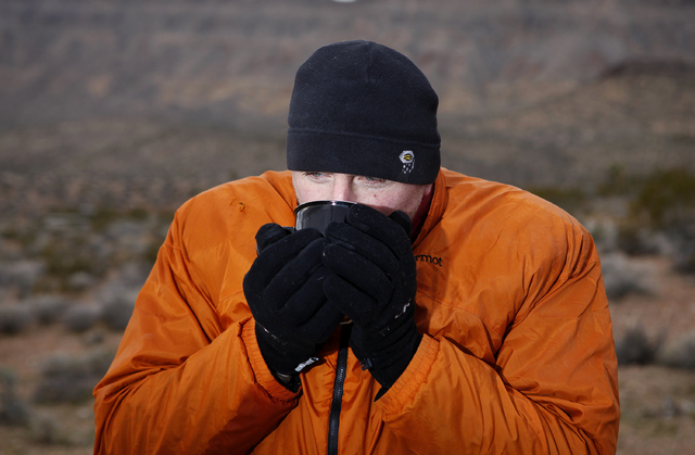 Erik Lawson sips a hot drink while camping at the Red Rock National Conservation Area campground near Las Vegas Wednesday, Dec. 4, 2013. People at the campground woke up to cold and damp weather.  ...