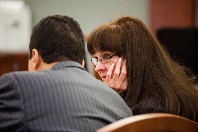 Defendant Linda Cooney, right, talks with her attorney Michael Castillo during a hearing in which she is accused of shooting her son from the Regional Justice Center in Las Vegas Friday, Dec. 20,  ...