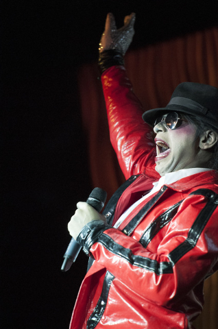 Sean E. Cooper entertains the crowd with his Michael Jackson impression during his show at Sin City Theatre inside Planet Hollywood hotel-casino in Las Vegas, Saturday, Dec. 7, 2013. (Erik Verduzc ...