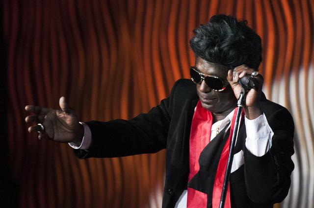 Sean E. Cooper performs an Elvis Presley impression during his show at Sin City Theatre inside Planet Hollywood hotel-casino in Las Vegas, Saturday, Dec. 7, 2013. (Erik Verduzco/Las Vegas Review-J ...
