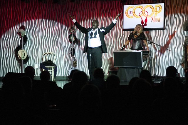Sean E. Cooper, left, performs during his show with Dar Brzezinski at Sin City Theatre inside Planet Hollywood hotel-casino in Las Vegas, Saturday, Dec. 7, 2013. (Erik Verduzco/Las Vegas Review-Jo ...