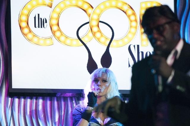Sean E. Cooper, right, performs a song during his show with Dar Brzezinski at Sin City Theatre inside Planet Hollywood hotel-casino in Las Vegas, Saturday, Dec. 7, 2013. (Erik Verduzco/Las Vegas R ...