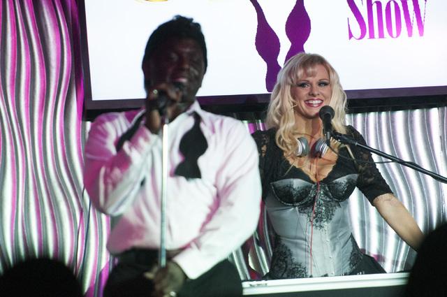 Sean E. Cooper, left, performs a song during his show with Dar Brzezinski at Sin City Theatre inside Planet Hollywood hotel-casino in Las Vegas, Saturday, Dec. 7, 2013. (Erik Verduzco/Las Vegas Re ...