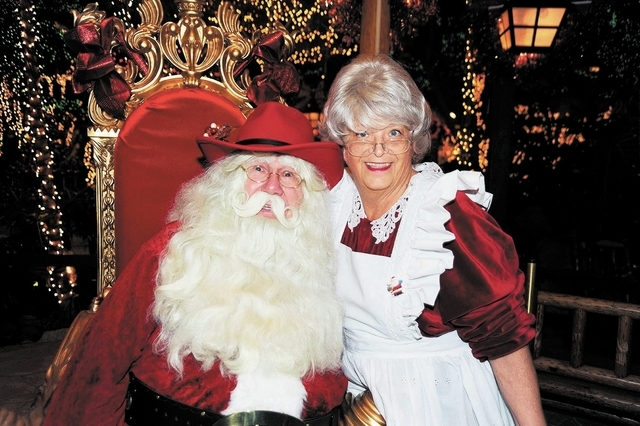 A couple dressed as Cowboy Santa and Mrs. Claus take part in last year's Winter Wonderland at Mystic Falls Park in Sam's Town, 5111 Boulder Highway. The North Pole couple also are set to attend  ...