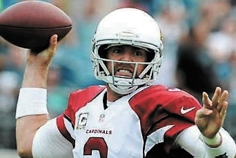 In this Nov. 17, 2013 file photo, Arizona Cardinals quarterback Carson Palmer (3) throws a pass as he is pressured by the Jacksonville Jaguars defense during the first half of an NFL football game ...