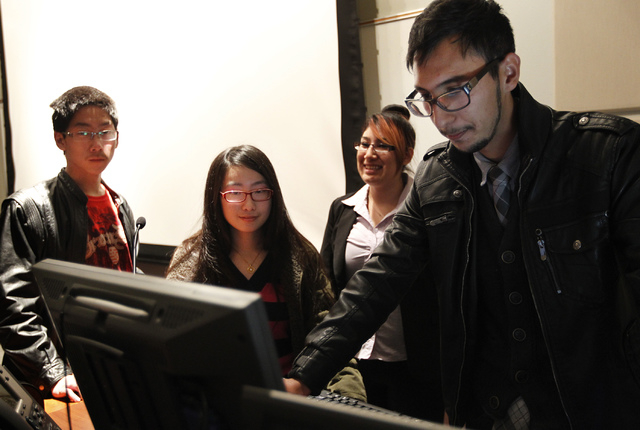 A group of students at the College of Southern Nevada, from left, Lawrence Wu, Vivien Wu, Michelle Mendez-Yela, and Jonathan Antoni, meet to watch a movie together as members of the school's new ...