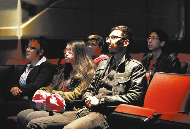 "Michelle Mendez-Yela, left, Vivien Wu and Jonathan Antonio watch the movie ""Sin Nombre"" with other members of CSN's revived Spanish Club. (Jason Bean /Las Vegas Review-Journal)"