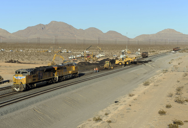 Repair crews work to clean up a derailed train near the 215 beltway and Range Road in Las Vegas, Monday, Dec. 9, 2013. According to a spokesperson with Union Pacific Railroad, one locomotive and 1 ...