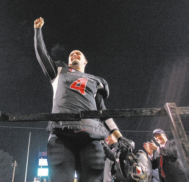 Fresno State senior quarterback Derek Carr raises his fist toward the crowd while celebrating a 24-17 win over Utah State in the Mountain West championship game Dec. 7 at Fresno, Calif. (AP Photo/ ...