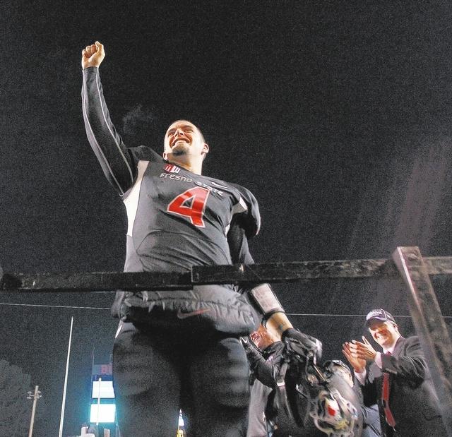 Fresno State senior quarterback Derek Carr raises his fist toward the crowd while celebrating a 24-17 win over Utah State in the Mountain West championship game Dec. 7 at Fresno, Calif. (AP Photo/ ...