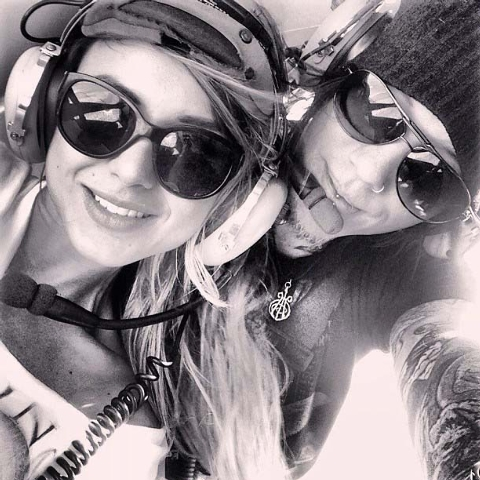 DJ Ashba, lead guitarist of Guns N' Roses, posted a photo of himself and his girlfriend on Instagram as they took a private ride in a Las Vegas police helicopter in August. (Courtesy/Instagram, @d ...