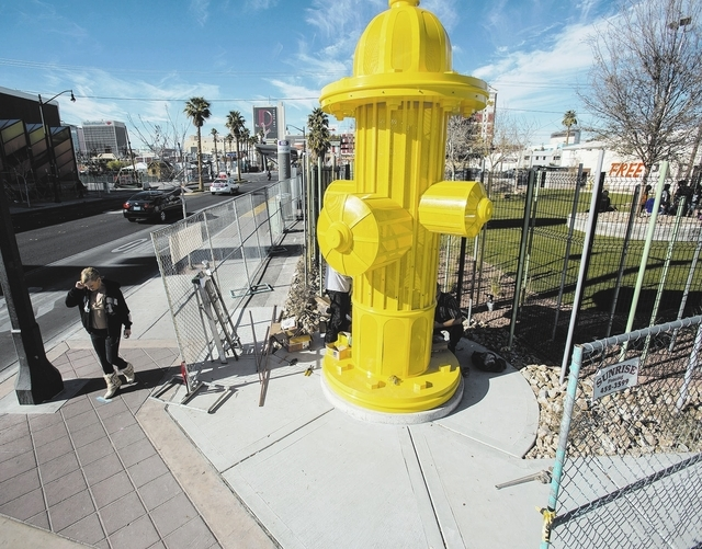 A fire hydrant water feature as seen Monday, Dec. 16, 2013 in front of the membership-based  dog facility at Fremont Street and 9th Street. The 5,000 square feet play area is schedule to open on S ...