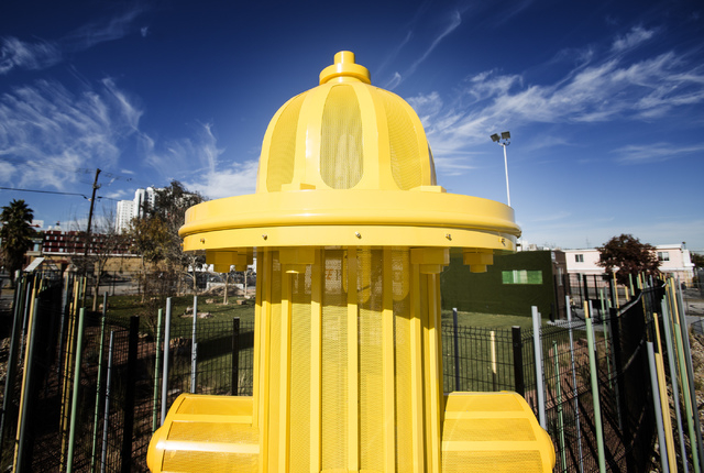 A fire hydrant water feature as seen Monday, Dec. 16, 2013 in front of the membership-based dog facility at Fremont Street and 9th Street. The 5,000 square feet play area is schedule to open on Sa ...