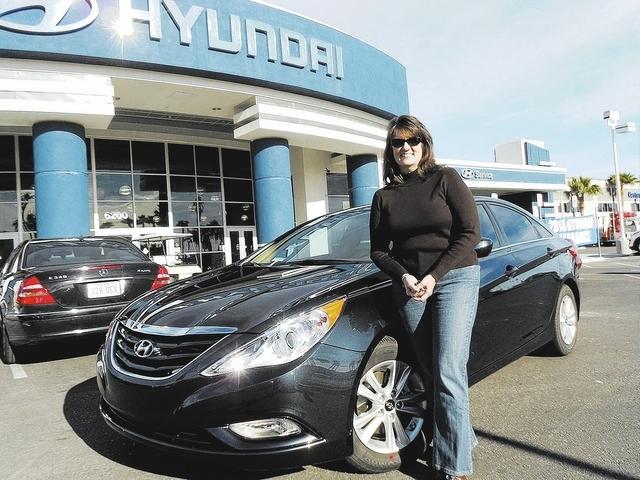 Courtesy photo  Substitute teacher Kristy Green stands by her 2013 Sonata at Centennial Hyundai.