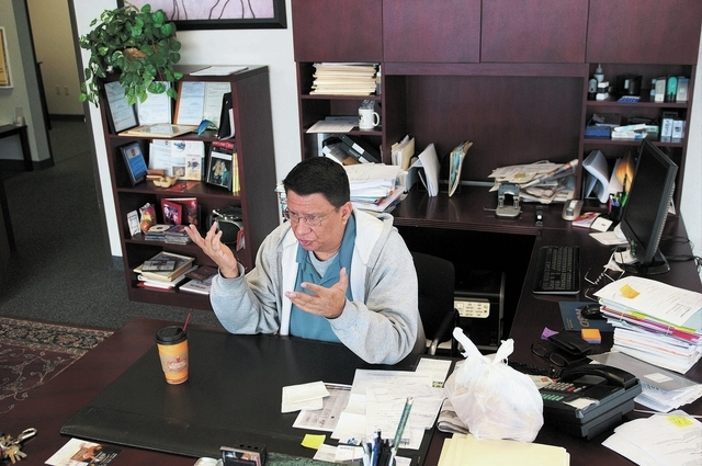 Attorney Alfonso Garcia speaks about the Nevada driver authorization cards during an interview at Aztec Insurance in Las Vegas Saturday, Dec. 28, 2013. Nevada will begin to issue driver authorizat ...