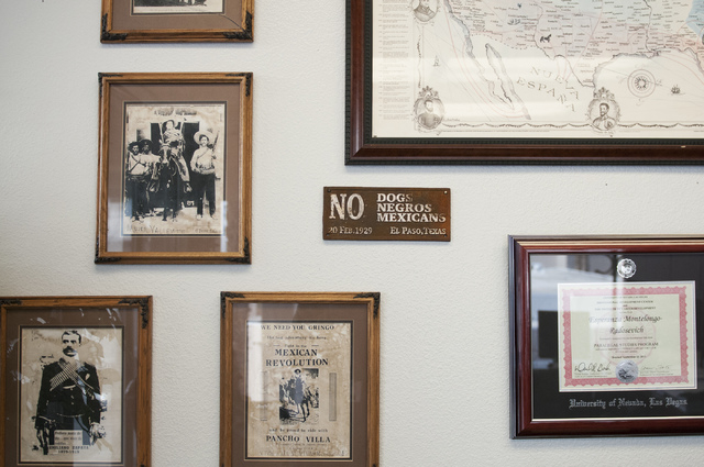 Historical images and signs are seen covering the office walls of Esperanza Motelongo, owner of Aztec Insurance in Las Vegas Saturday, Dec.  28, 2013. (Erik Verduzco/Las Vegas Review-Journal)