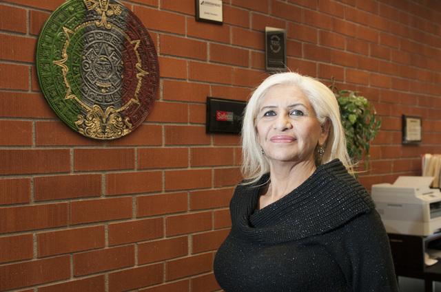 Esperanza Montelongo, owner of Aztec Insurance, poses for a portrait at her office in Las Vegas Saturday, Dec. 28, 2013. (Erik Verduzco/Las Vegas Review-Journal)