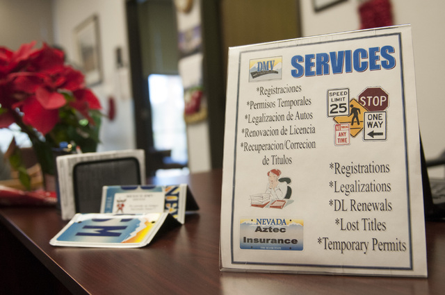 A sign at Aztec Insurance displays the services offered at their offices in Las Vegas Saturday, Dec. 28, 2013. (Erik Verduzco/Las Vegas Review-Journal)