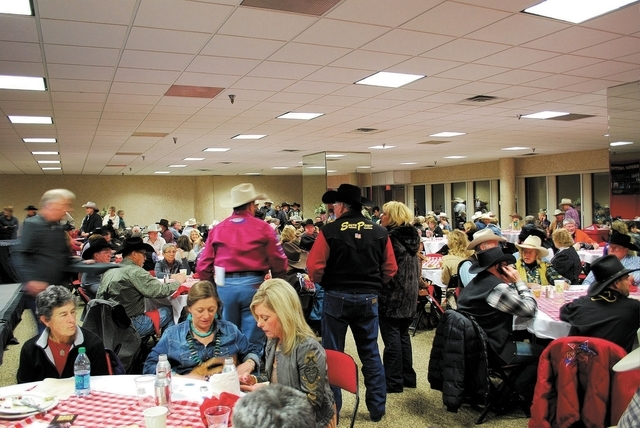 NEAL REID/SPECIAL TO THE LAS VEGAS REVIEW-JOURNAL Rodeo VIPs, Hall of Famers and royalty gather in the Wrangler NFR Gold Card Room each night before the rodeo at the Thomas & Mack Center to social ...