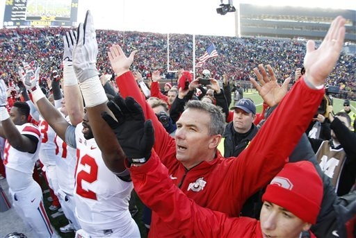 Ohio State head coach Urban Meyer joins his team in singing the school's alma mater after their 42-41 win over Michigan in an NCAA college football game Saturday, Nov. 30, 2013 at Michigan Stadium ...