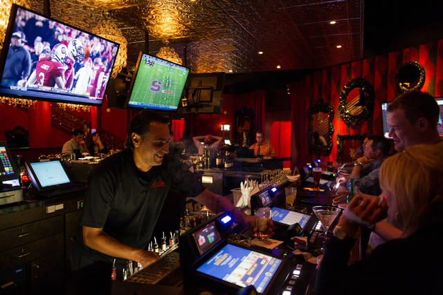 Tony, who declined to give his last name, serves up a drink to a customer at Elixir, 2920 N. Green Valley Pkwy. in Henderson, on Saturday, Nov. 30, 2013. (Chase Stevens/Las Vegas Review-Journal)