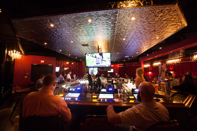 People drink and watch TV at the bar area at Elixir, 2920 N. Green Valley Pkwy. in Henderson, on Saturday, Nov. 30, 2013. (Chase Stevens/Las Vegas Review-Journal)