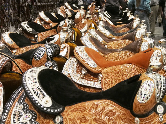 Fancy saddles are seen at the Dale Chavez Company booth at the National Finals Rodeo Cowboy Christmas Gift Show in the Las Vegas Convention Center, Thursday, Dec. 5, 2013.  (Jerry Henkel/Las Vegas ...