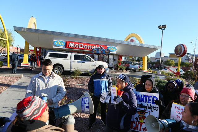 Laura Martin, front left, communications director of Progressive Leadership Alliance of Nevada, speaks during a protest outside McDonald's on 2248 Paradise Road Thursday, Dec. 5, 2013, in L ...