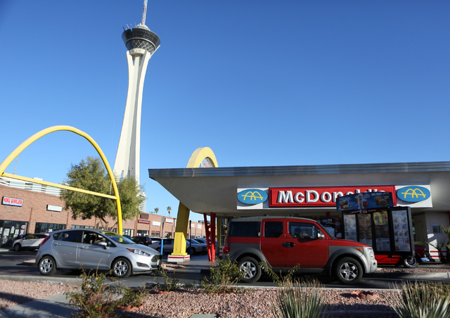 Cars stop in a drive-thru lane at McDonald's on 2248 Paradise Road Thursday, Dec. 5, 2013, in Las Vegas. Community members and fast-food workers gathered outside the restaurant as part of a ...