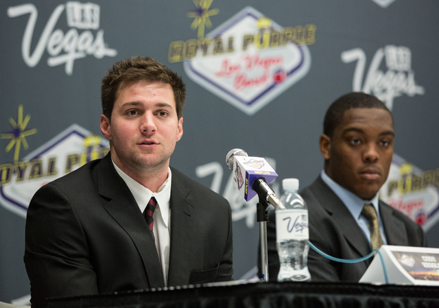 USC's quarterback Cody Kessler, left, and outside line backer Devon Kennard, second from left, attend a press conference at the Las Vegas Convention Center on Friday, Dec. 20, 2013. USC will compe ...