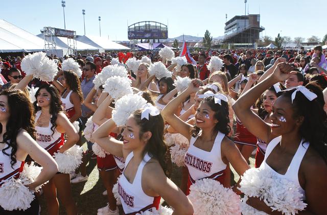 Bulldog cheerleaders take part in pre-game festivities before USC takes on Fresno State at the Royal Purple Las Vegas Bowl at Sam Boyd Stadium in Las Vegas on Dec. 21, 2013. (Jason Bean/Las Vegas  ...