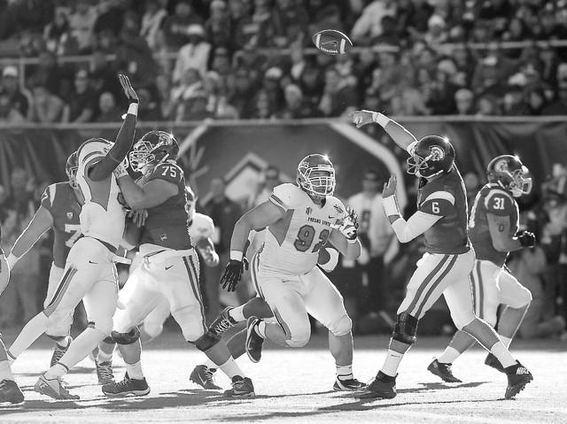 USC quarterback Cody Kessler (6) makes a pass over Fresno State's Tyeler Davison (92) during the Royal Purple Las Vegas Bowl at Sam Boyd Stadium in Las Vegas on Dec. 21, 2013. (Jason Bean/Las Vega ...