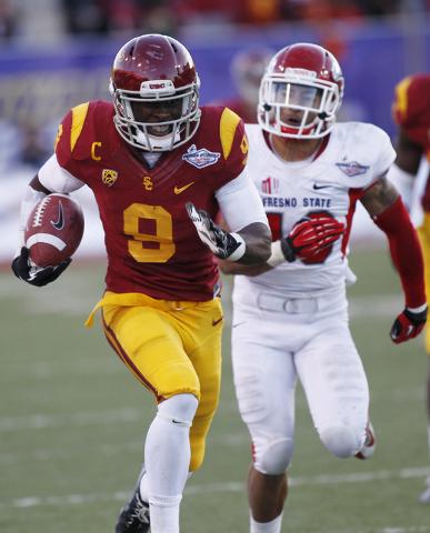 USC's Marqise Lee (9) runs past Fresno State's Derron Smith (13) during the Royal Purple Las Vegas Bowl at Sam Boyd Stadium in Las Vegas on Dec. 21, 2013. (Jason Bean/Las Vegas Review-Journal)