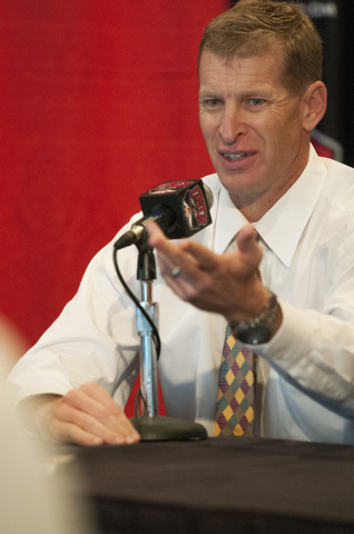 UNLV coach Bobby Hauck reacts to his team's invitation to the Heart of Dallas Bowl during a press conference at Thomas & Mack Center in Las Vegas, Monday, Dec. 9, 2013. (Erik Verduzco/Las Vegas Re ...