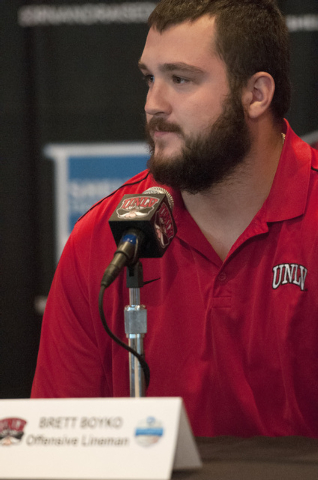 UNLV offensive lineman Brett Boyko reacts to his team's invitation to the Heart of Dallas Bowl during a press conference at Thomas & Mack Center in Las Vegas, Monday, Dec. 9, 2013. (Erik Verduzco/ ...