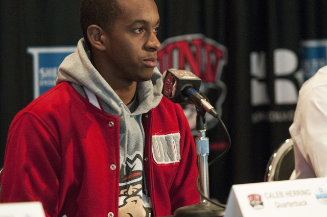 UNLV quarterback Caleb Herring reacts to his team's invitation to the Heart of Dallas Bowl during a press conference at Thomas & Mack Center in Las Vegas, Monday, Dec. 9, 2013. (Erik Verduzco/Las  ...