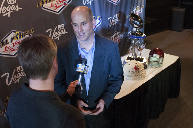 University of Southern California interim head coach Clay Helton is interviewed by a reporter at the D hotel-casino in Las Vegas about the upcoming Royal Purple Las Vegas Bowl between the Fresno S ...
