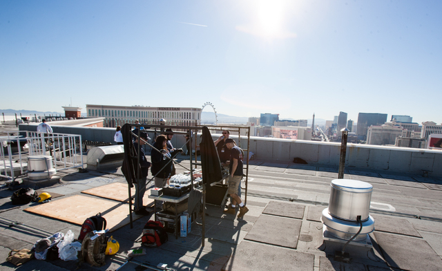 Pyrotechnicians from Fireworks by Grucci talk around the command center during preparation for the New Year's Eve fireworks show on the roof of the Treasure Island in Las Vegas on Monday, Dec. 30, ...