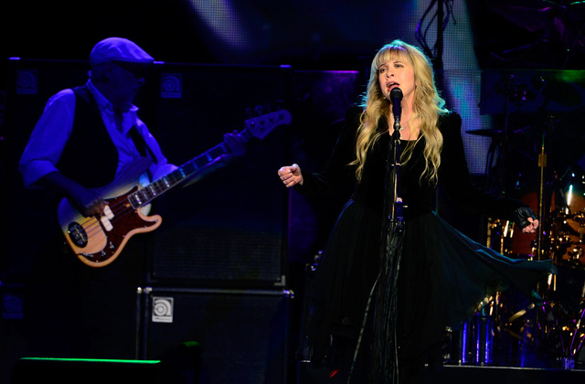 Bassist John McVie, left, and singer Stevie Nicks of Fleetwood Mac perform at the MGM Grand Garden Arena on Monday, Dec. 30, 2013. (David Becker/Las Vegas Review-Journal)