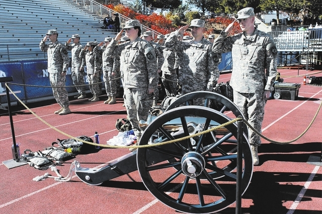 Members of the University of Nevada Reno's ROTC stand at attention while guarding the Fremont Cannon trophy before the start of the big rivalry football game between UNLV and UNR in Reno on Oct. 2 ...
