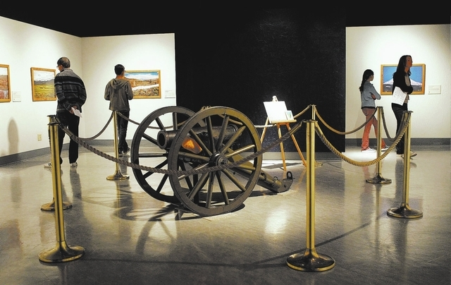 The Sturm family from Carson City explores the original Fremont Cannon exhibit at the Nevada State Museum in Carson City on Oct. 25, 2013. The photos on the walls show locations where John C. Frem ...
