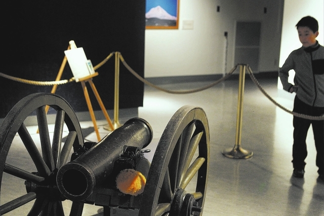 9-year-old William Liu, from Reno, checks out the original Fremont Cannon exhibit at the Nevada State Museum in Carson City on Oct. 25, 2013. (Jason Bean/Las Vegas Review-Journal)