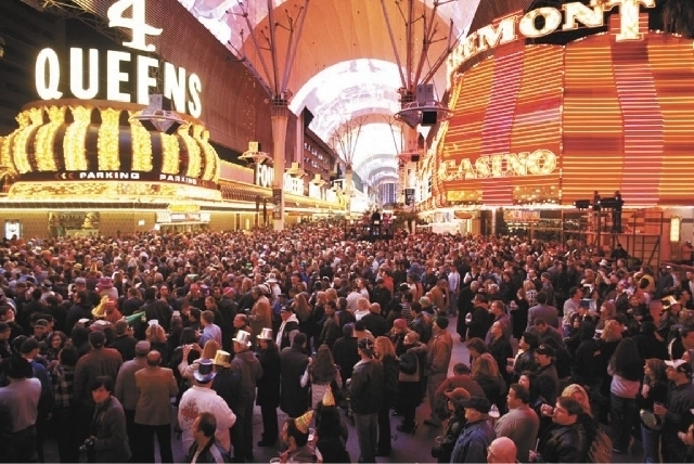The Downtown Countdown at the Fremont Street Experience, shown in 2012, is among the more popular off-Strip New Year's Eve celebrations. (John Locher/Las Vegas Review-Journal File Photo)