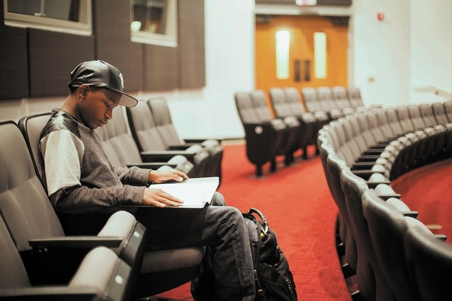 Fifteen-year-old UNLV student Ke'Andre Blackston Jr. goes over notes before he performs in his Musical Theater class at the Paul Harris Theatre on the UNLV campus in Las Vegas Wednesday, Nov. 27,  ...