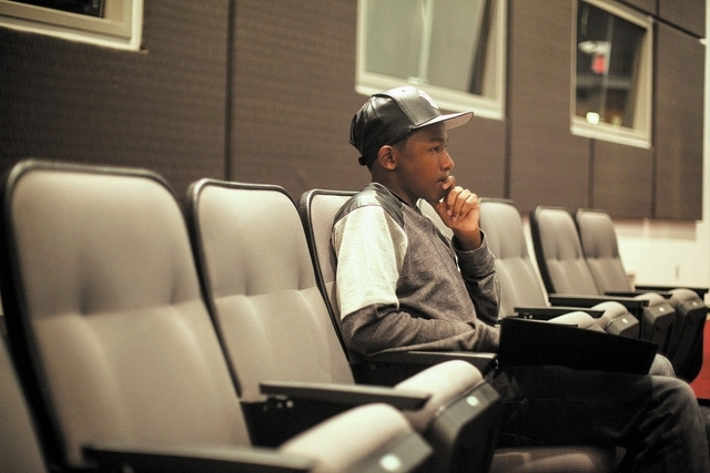 Fifteen-year-old UNLV student Ke'Andre Blackston Jr. listens as students take turns performing in Musical Theater class at the Paul Harris Theatre on the UNLV campus in Las Vegas Wednesday, Nov. 2 ...