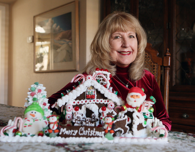 Judy DuCharme, shown with her homemade gingerbread house, is the winner of the Review-Journal gingerbread house contest. (Ronda Churchill/Las Vegas Review-Journal)